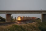 The CP's Train 199 Approaches Under a Setting Sun