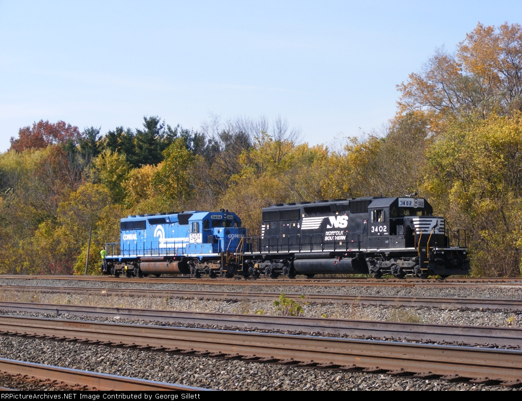 NS 3402 backs down to couple to the BNSF coal train, some BNSF trains are not equipped with cab signals. Thats why NS engines have to lead this consist.
