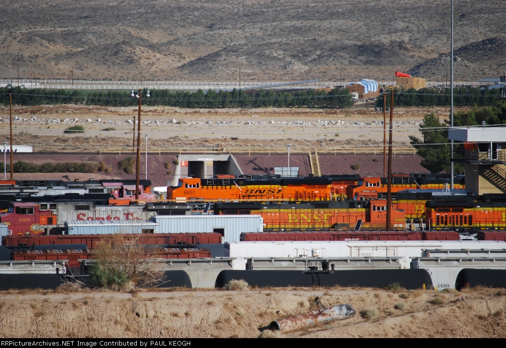 BNSF 6651 with the sun reflecting off her Very Brand New BNSF Swoosh Logo Paint waits for her next assignment out of BNSF Barstow.