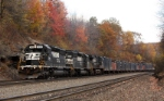 NS 3414 and 3373 lead westbound loaded trash through Bennington Curve Gallitzin PA