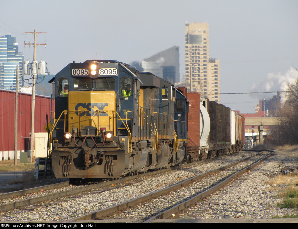 CSX 8095 leads L326-28 away from downtown as it starts east