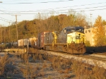 The evening sun shines off of Q335 as it rolls into Plaster Creek