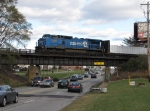 CSX 7302 rolls over 28th St with Q327-31