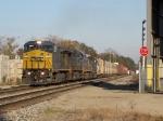 CSX 7342 leads Q334-07 eastward under the bright morning sun