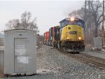 Q196-09 rolls east through Seymour with mixed domestic and international containers in tow