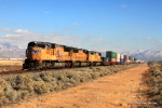 UP 4830 accelerates wesbound with a priority intermodal train