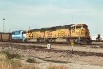 Coal train rolls east through University