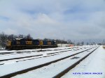 Q275 picks up their train and is about to leave Memphis Jct Yard in blowing snow