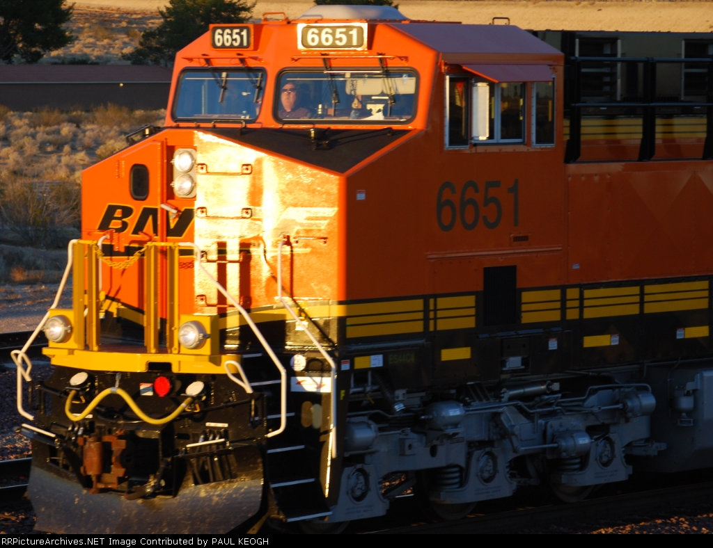 Close in shot of the Crew of BNSF 6651 as they pull west into the setting sun on Halloween.