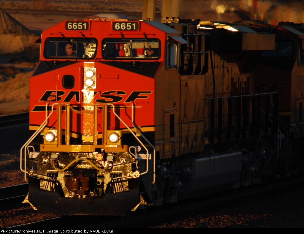 BNSF 6651 leads a westbound Z as the sun sets on the crew and this Very Brand New ES44C4.