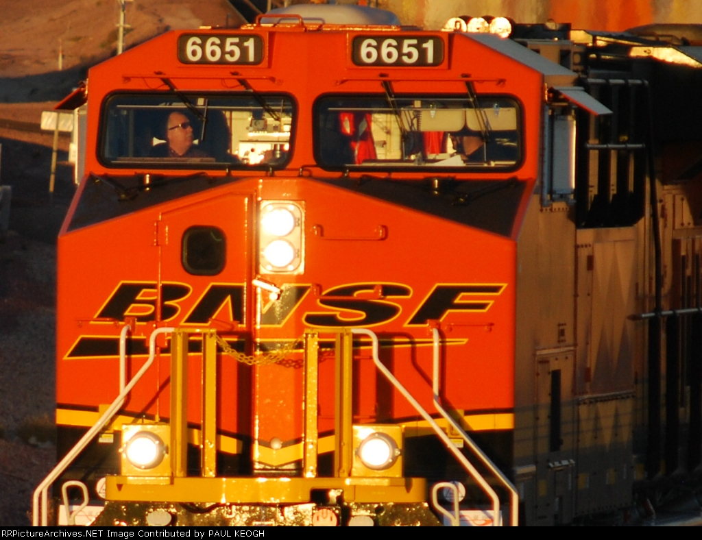 Up close shot of the crew of BNSF 6651 as they roll west into a California sunset.