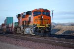 BNSF 7920 rolls west with her crew door ajar as a rear DPU unit on a westbound Z-Train.