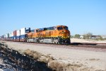 BNSF 7877 with BNSF 6631 behind her slow down for a crew swap at the BNSF Barstow yard.