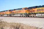 BNSF 6627 with the sun glistening of her BNSF Swoosh Logo rolls east.