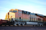 BNSF 6644 with the rear of BNSF 7914 wait to move east.