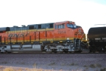 BNSF 7914 waits as another Westbound manifest rolls by her.