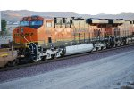 BNSF 7862 rolls eastbound into the rising sun behind BNSF 7495.
