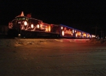 CP 9713 makes a brief stop at Millet with the CP Holiday train