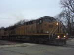 UP 6591 leads coal MTs from Sheboygan across Clement Avenue