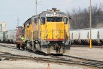 GMTX 2301 and UP 665 kick cars around the south end of Butler Yard