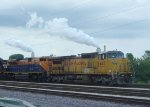 UP 9447 and its colorful guest finally pull out of the power plant