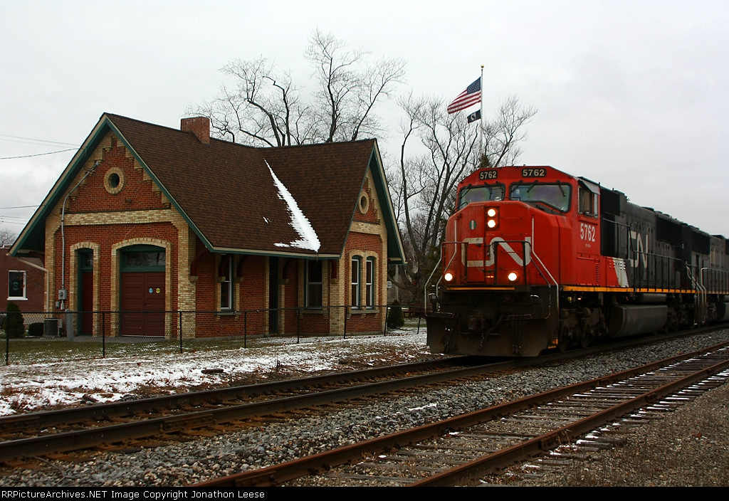 490 passing the nicely restored depot