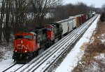 CN 5781 and 2585 head west with a mixed freight
