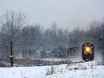 L326-06 heads east as the snow falls