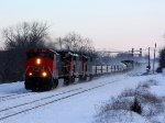 CN 2507 hustles M397 through Durand as the sun rises