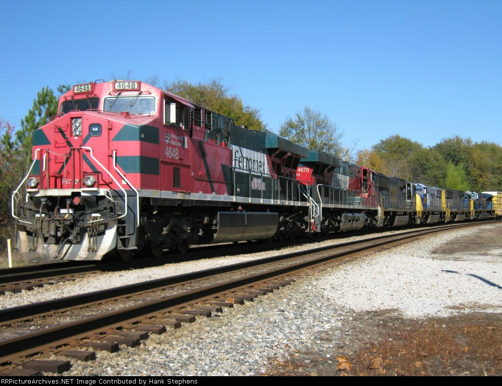 FXE and FXE leased CSX units on CSX AWP-WofA Subdivision Q601 headed westward from Waycross to Mobile and points west.