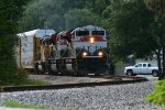 FEC SD70M-2 105 approaches the Wayne Ave. crossing in New Smyrna Beach, FL
