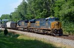 CSX ES44AH 908 climbs out of the Miami river valley through Taylorsville Metropark, Dayton, OH