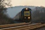 CSX C40-8 7540 leads a northbound grain train through Dayton, OH along Danner Ave.