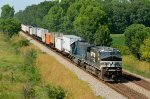 NS C40-9W 9765 and HLCX 6540 blast a pig/stack train out of Columbus, OH