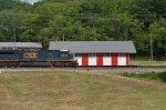 CSX AC60CW 5016 passes old freight housei ni Miamisburg, OH