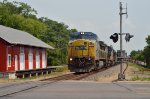 CSX C40-8W 7328 rolls a mixed train south through Miamisburg, OH at the Linden Ave. crossing.