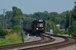 NS SD60 6619 enters Circleville, OH with a solid train of BNSF covered hoppers.