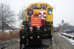 Engineer Steve Weiss, Santa, and  the US Marine Corps reps pose on the  NYSW 3634