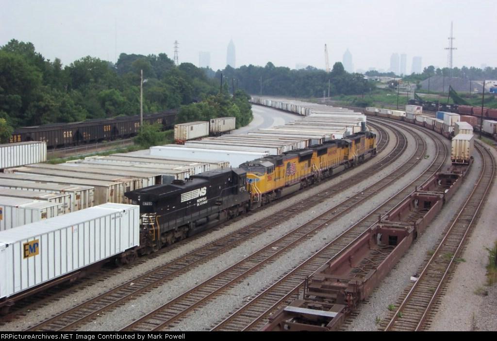 UP 4528 & UP 4154 & UP 3861 & NS 8759 building at train at Inman Yard