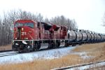CP 9142 waits for the CP Holiday train to clear Ponoka before continuing its journey south to Calgary