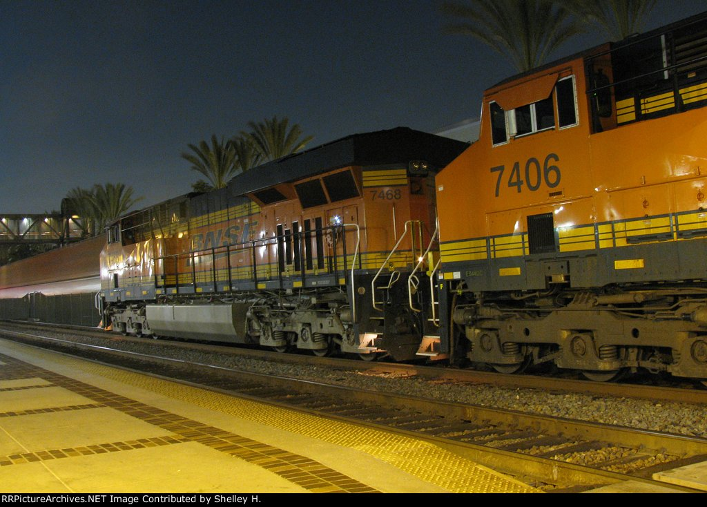 A freight train passes the stopped engines on track 3