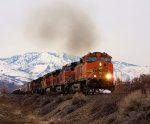 BNSF 5528 puts the hammer down with a nice back drop.