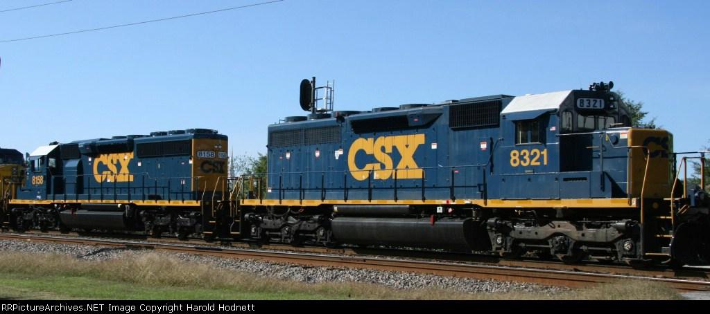 CSX 8321 & 8158 display their YN3 paint