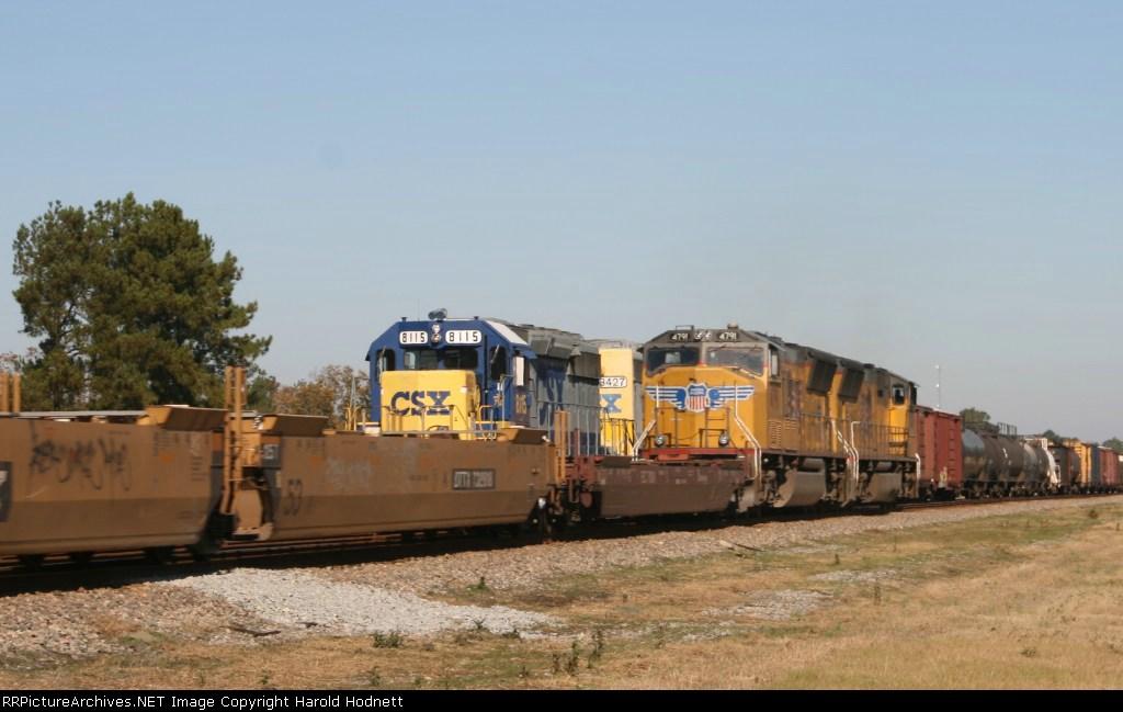 CSX 8115 leads train Q 491 past UP powered train H100