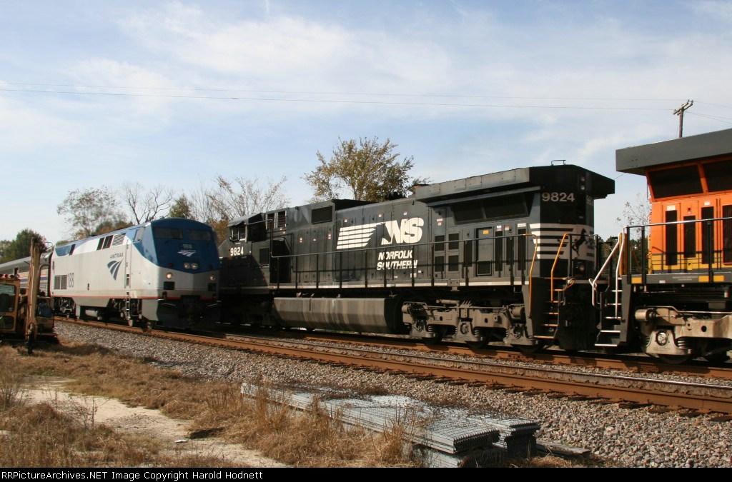 NS 9824 on CSX train Q491 meets Amtrak train 90