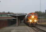 BNSF 4808 leads a CSX train northbound past the passenger station