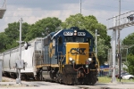 CSX 8097 leads a train towards Bennett Yard on the Andrews sub under threatening skies