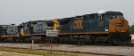 CSX 5105 leads two older GE's into the yard