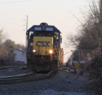 CSX 2313 approaches Evans Street with a work train