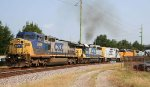 CSX 7848 leads a train southbound